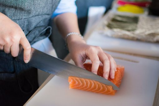 person-slicing-meat-on-white-chopping-board-1409050-scaled-1.jpg